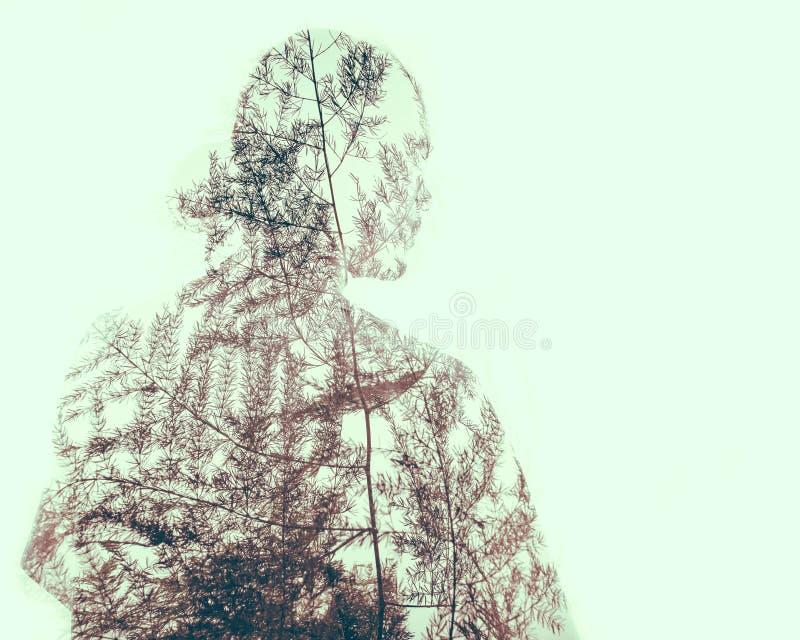 Dwoisty ujawnienie istota ludzka z natura wzorami obrazy stock