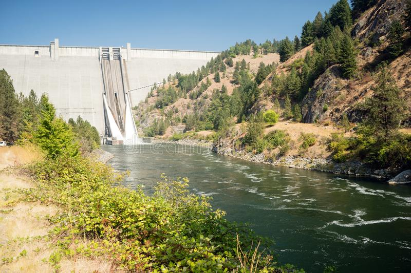 Dworshak Dam Concrete Gravity North Fork Clearwater River Idaho. The spillway drains water from the dam down into the Clearwater River in Idaho royalty free stock photos