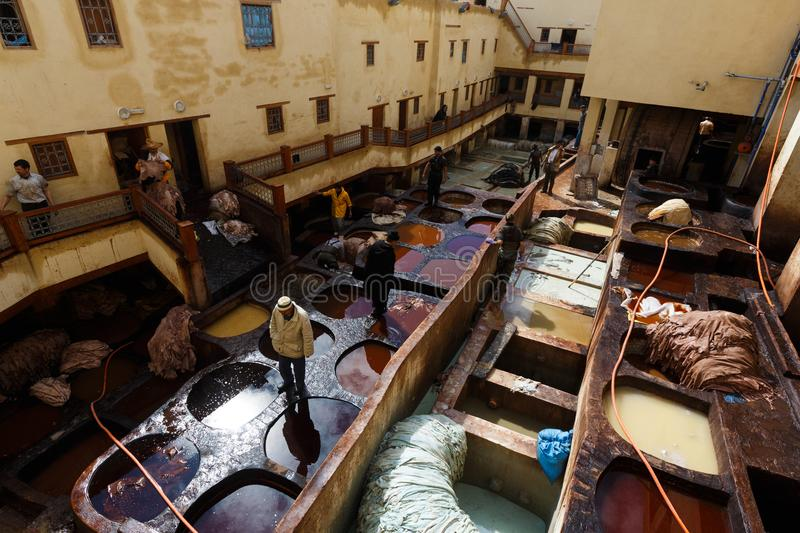 Dye reservoirs in tannery in Fes, Morocco, where the world famous moroccan leather is made stock photo