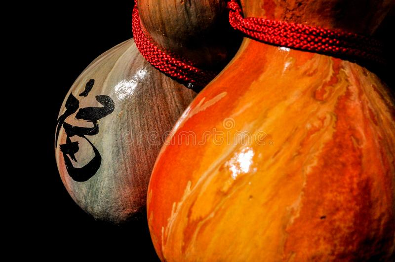 Dyed and painted gourd crafts with a handwritten Chinese character meaning `good fortune` royalty free stock photography