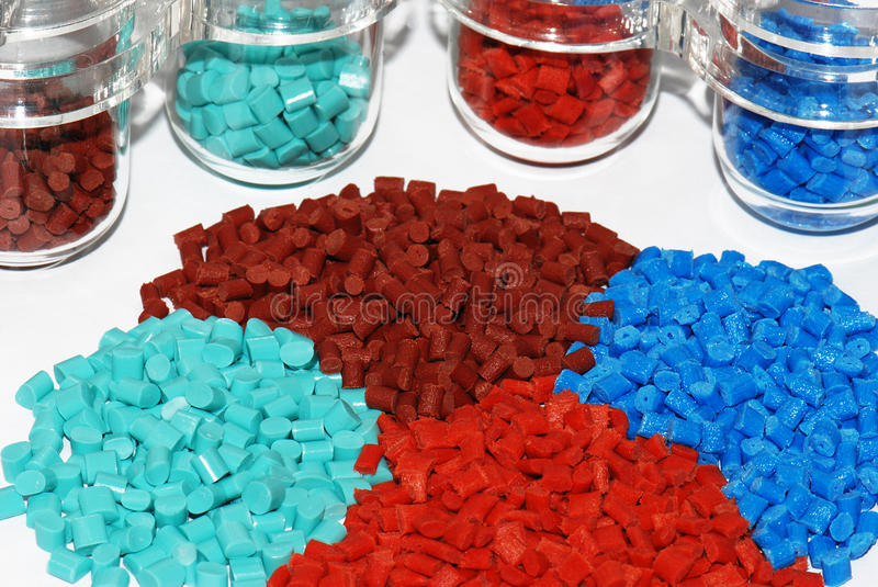 Dyed Plastic Granulate In Test Glasses Royalty Free Stock Photo
