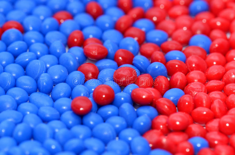 Dyed polymer resin. Closeup of red and blue dyed polymer resins royalty free stock photography