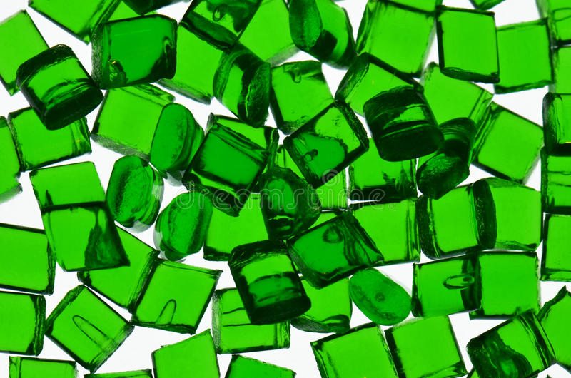 Dyed polymer resin. Closeup of transparent green dyed polymer resin on white royalty free stock photo