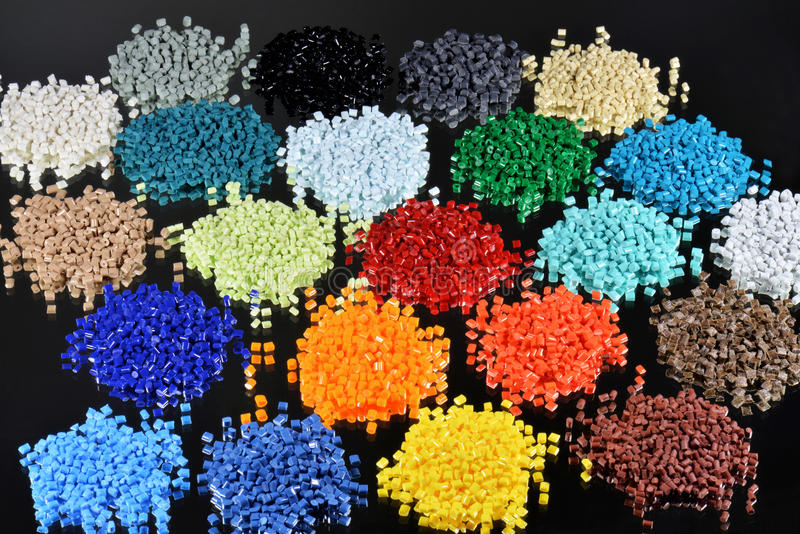 Dyed polymer resin. A variation of dyed polymer resins on black background stock image