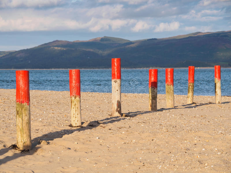 Dyfi Estuary and Clouds. Colourful marker posts and estuary at Ynyslas at the head of the Dyfi Dovey estuary just north of Borth, Ceredigion, Wales royalty free stock photos