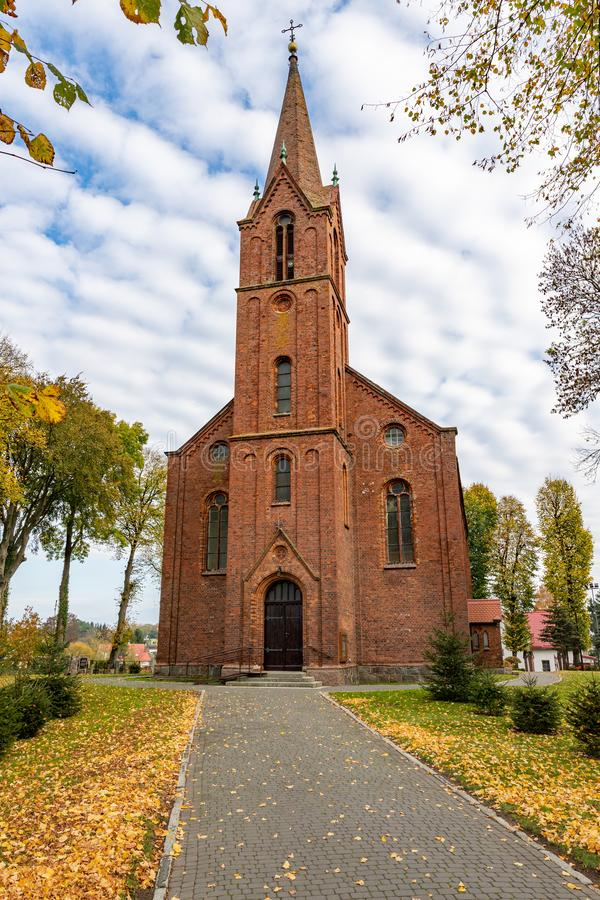 Dygowo, zachodniopomorskie / Poland - October, 22, 2019: Christian church in Central Europe. Old brick temple building. Autumn season, ancient, architecture royalty free stock images