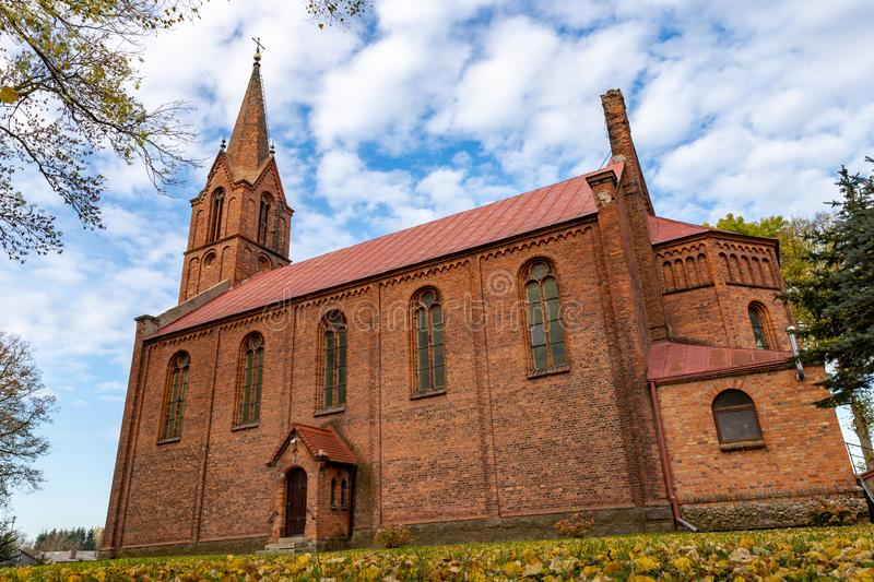 Dygowo, zachodniopomorskie / Poland - October, 22, 2019: Christian church in Central Europe. Old brick temple building. Autumn season, ancient, architecture royalty free stock photo