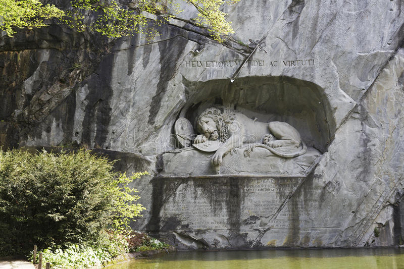 Dying Lion carved in rocky wall in Lucerne royalty free stock photos