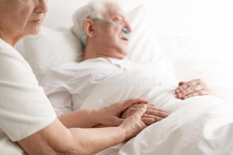 Dying senior man and his wife royalty free stock photos