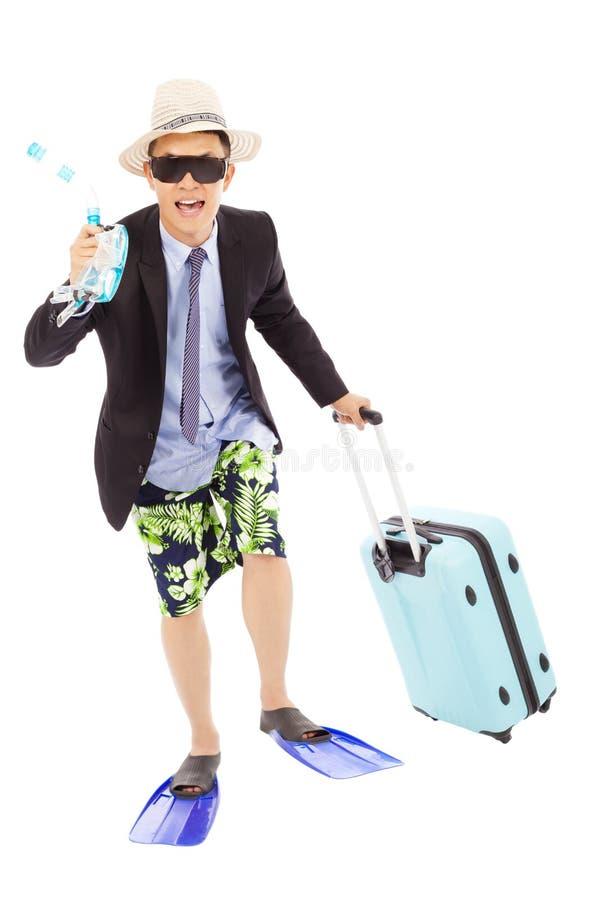 Dykapparatutväxling och bagage för rolig affärsman hållande royaltyfri foto