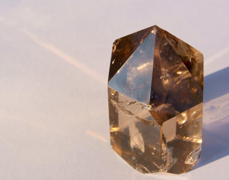 Dymiący Kwarcowy kryształ w Sun obrazy royalty free