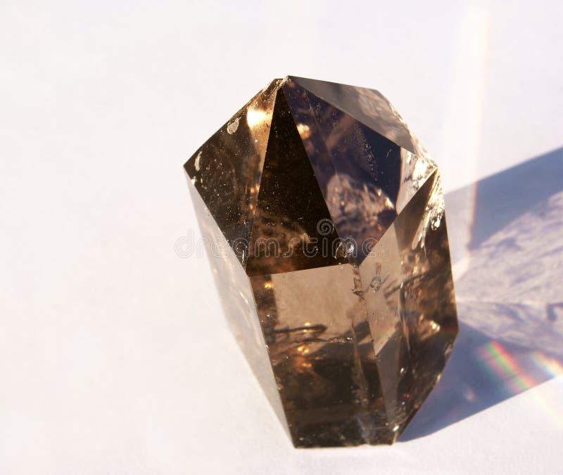 Dymiący Kwarcowy kryształ w Sun zdjęcie royalty free