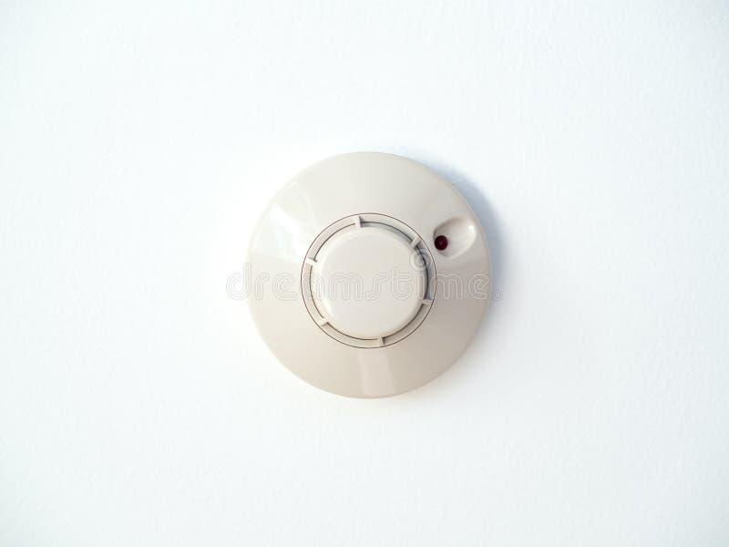 Dymny detektor na białym suficie fotografia royalty free