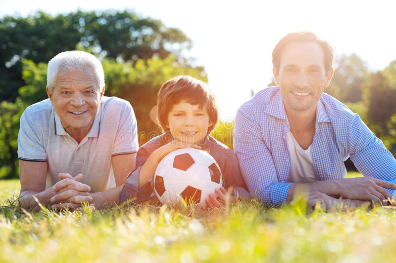 Dynamic charming family resting after a good game royalty free stock photo
