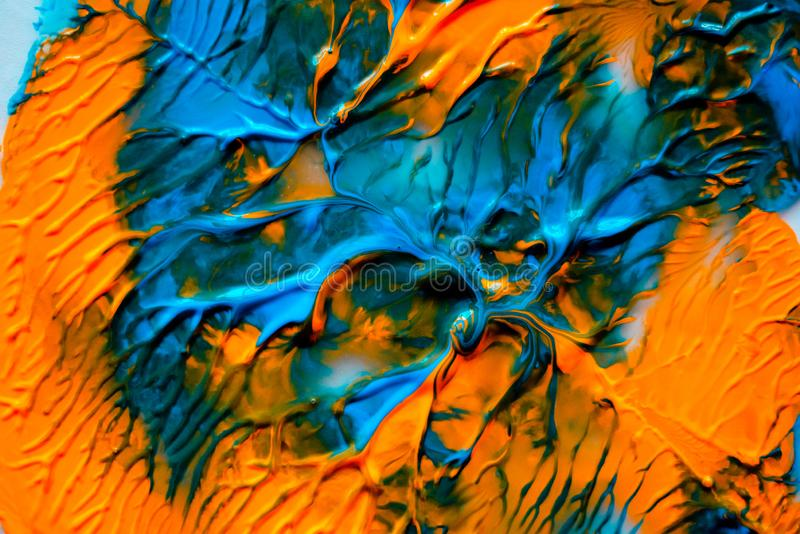 Dynamic fluid color paint splashes background. Blue and orange mixed liquid backdrop. Abstract marbling effect. Dynamic fluid stock images