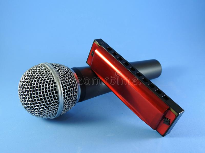 A dynamic microphone and a diatonic harmonica royalty free stock photography