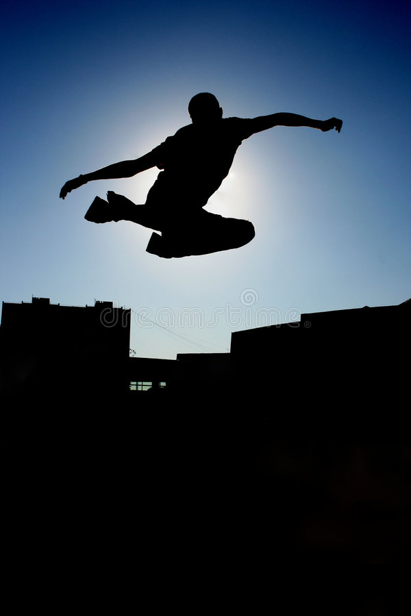 Dynamic jump. Silhouette of man, dynamic jump royalty free stock photography
