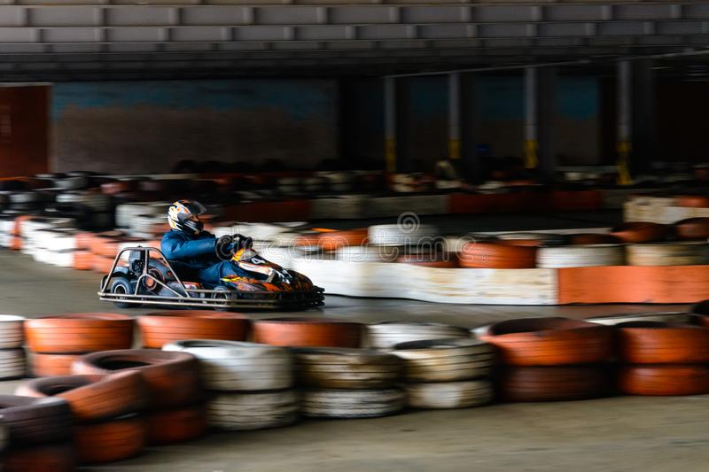 Dynamic karting competition at speed with blurry motion on an equipped racecourse stock photo