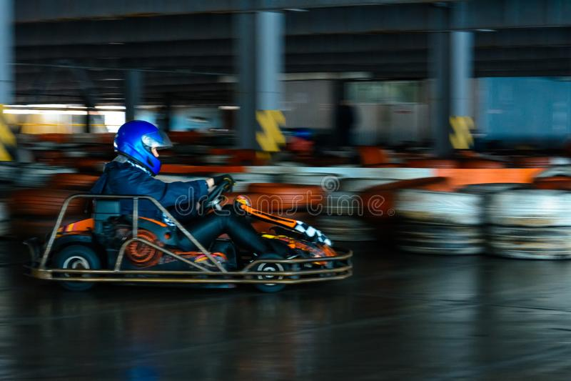 Dynamic karting competition at speed with blurry motion on an equipped racecourse stock images