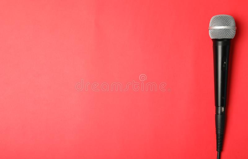 Dynamic microphone on color background, top view royalty free stock photography