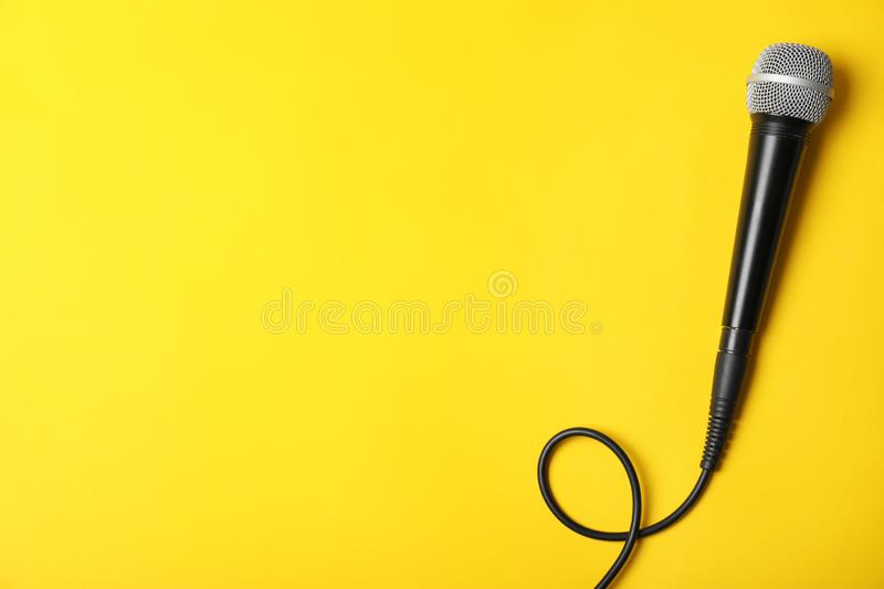Dynamic microphone on color background, top view royalty free stock photo
