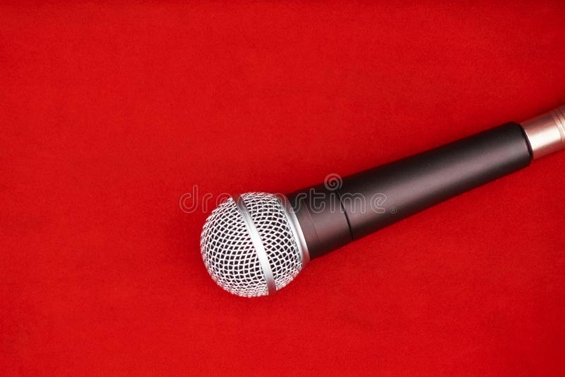Dynamic microphone on red floor for music royalty free stock image