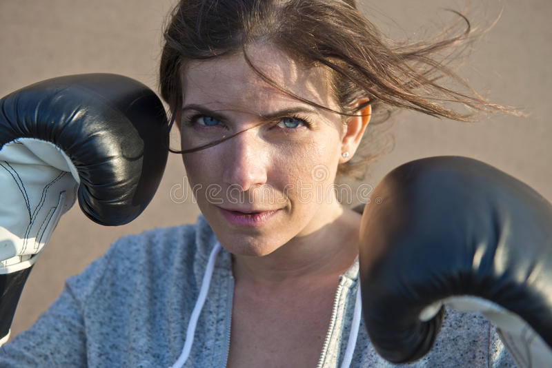 Dynamic and natural portrait of a sporty woman stock photos