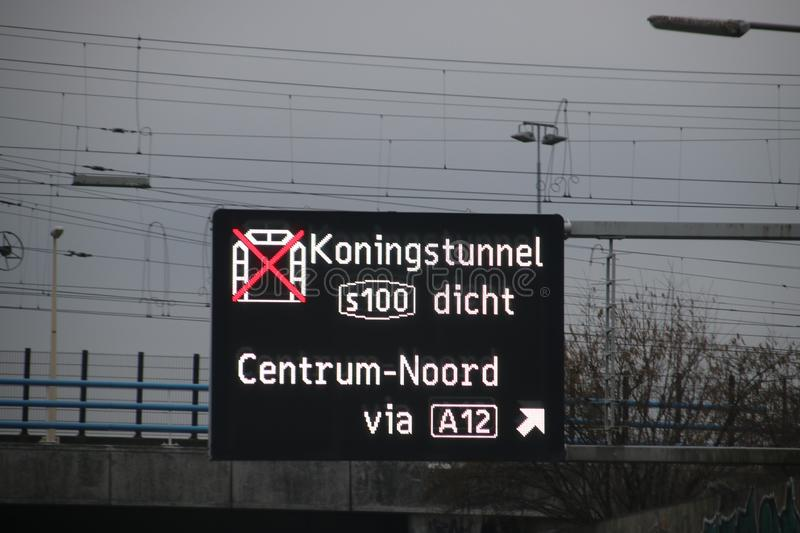 Dynamic route information panel warns for closed tunnel named Koningstunnel on S100 in The Hague on highway A4. royalty free stock image