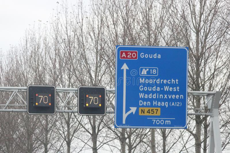 Dynamic speed signs flashing orange light and shows mandatory speed on motorway A20 at Moordrecht. stock photos