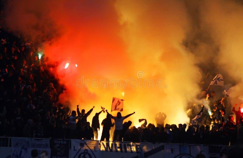 Dynamo Kyiv supporters burn flares stock image