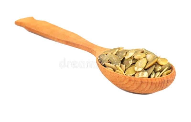 Dyniowego ziarna nasiona w łyżce zdjęcia royalty free
