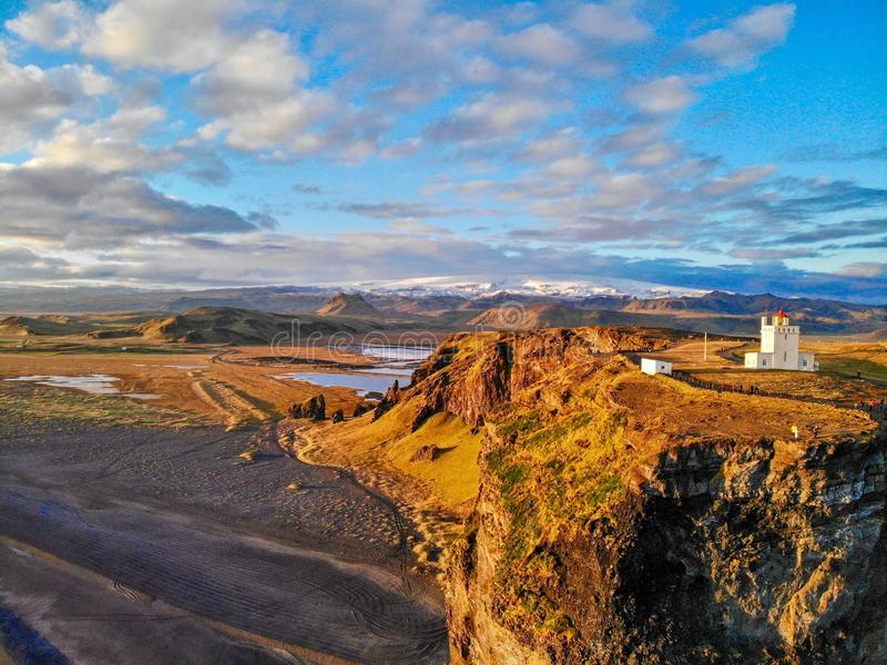 Dyrholaey Lighthouse. vik. Iceland. Picture taken from a bird`s eye view from the ocean royalty free stock image