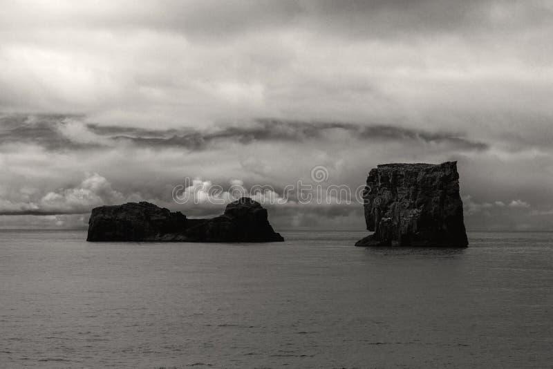 Dyrholay Rocks Iceland. Dyrhlaey Cape Portland at south coast of Iceland, Vik in black and white stock photo