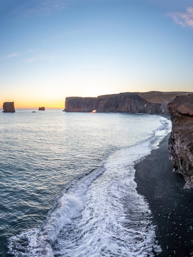 Dyrholaey arch with hole in evening of Iceland stock image