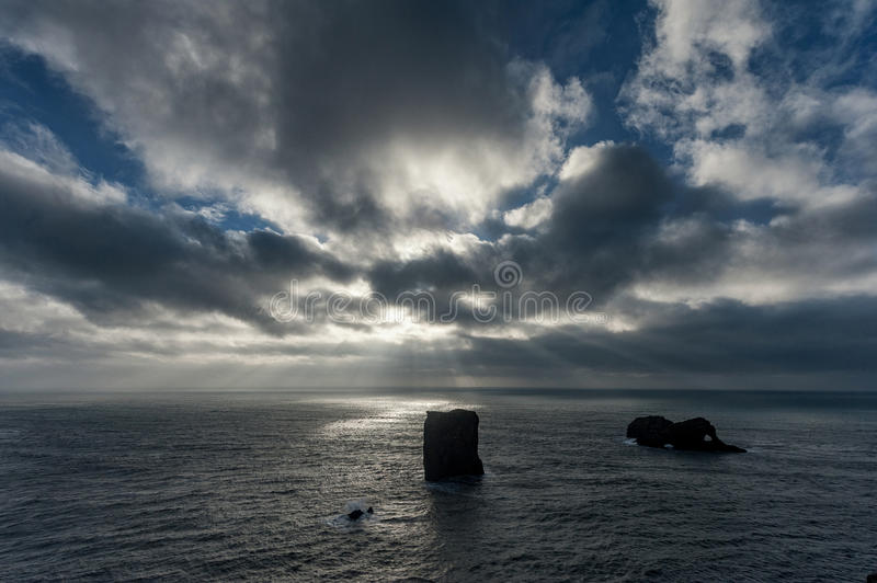 Dyrholaey Area in Iceland. Close to Black Sand Beach. Sunrise. Cloudy Sky.  royalty free stock photos