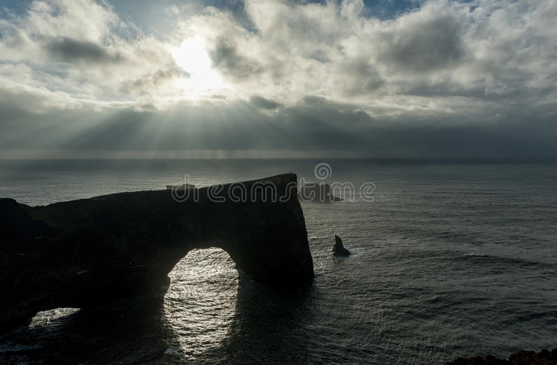Dyrholaey Area in Iceland. Close to Black Sand Beach. Sunrise. Cloudy Sky. Sunlight Above the Water. stock images