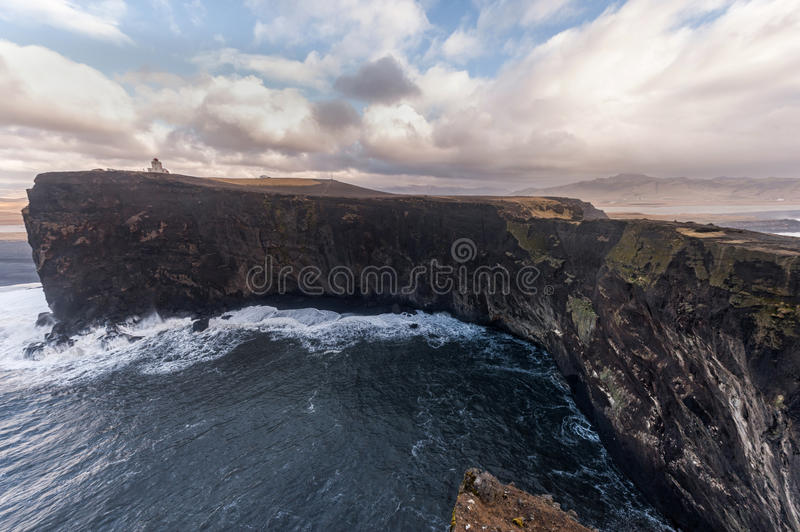 Dyrholaey Area in Iceland. Close to Black Sand Beach. Sunrise. Lighthouse in Background. Dyrholaey Area in Iceland. Close to Black Sand Beach. Sunrise stock photography