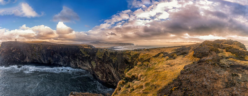 Dyrholaey Area in Iceland. Close to Black Sand Beach. Sunrise. Lighthouse in Background. Panorama. Dyrholaey Area in Iceland. Close to Black Sand Beach. Sunrise stock images