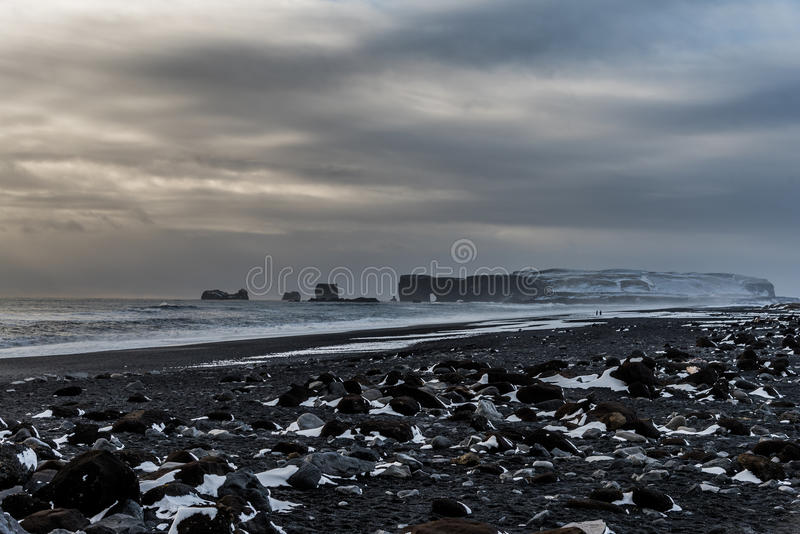 Dyrholaey and the black sand beach, Iceland. View of Dyrholaey from black sand beach, Vik, Iceland royalty free stock images