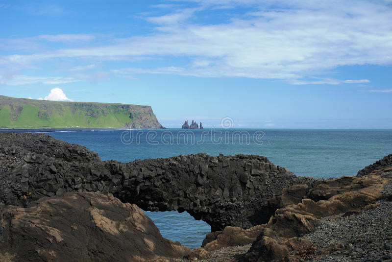 Dyrholaey cape, natural stone arch. South Iceland royalty free stock images