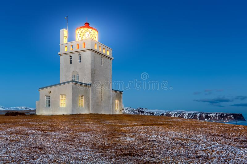 Dyrholaey lighthouse at dusk. The light station at Dyrholaey was established in 1910, near the village Vik, on the southern tip of Iceland royalty free stock image