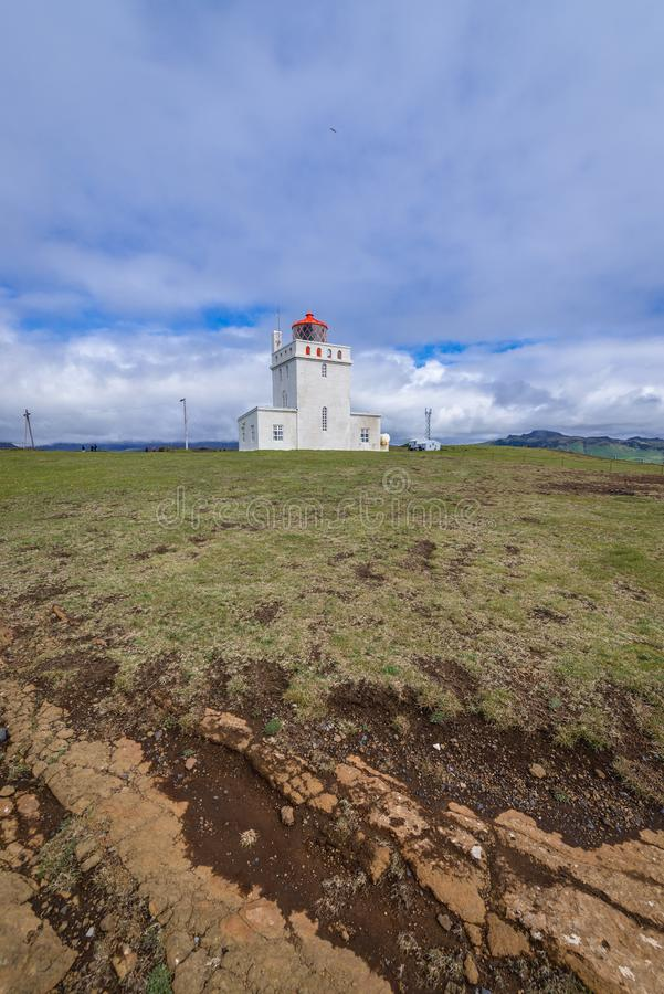 Dyrholaey lighthouse in Iceland. Dyrholaey lighthouse on a cape in south region of Iceland royalty free stock images