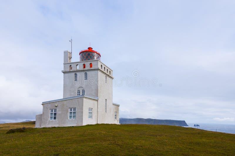 Dyrholaey Lighthouse, Iceland. Dyrhólaey Lighthouse near the rocky arch, Iceland stock images