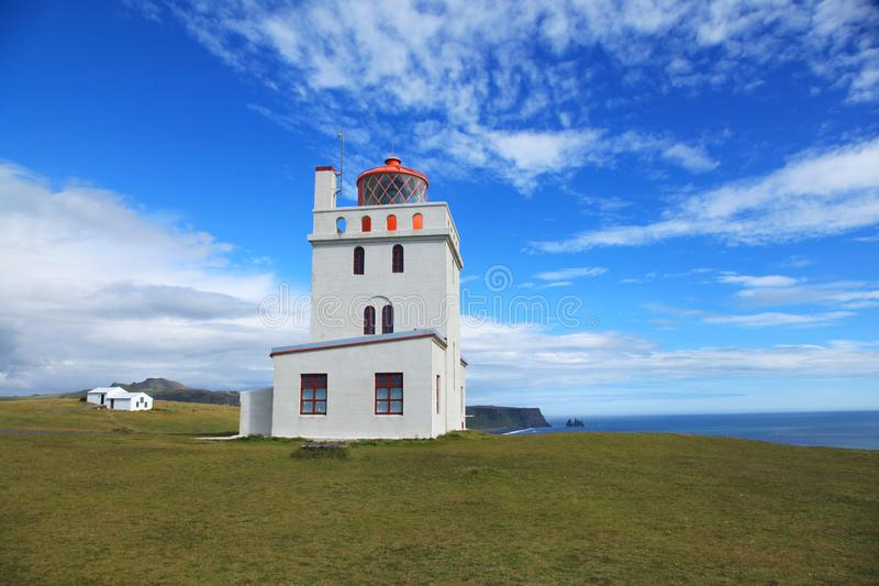 Dyrholaey Lighthouse in Iceland. Dyrholaey Lighthouse on a sunny day in Iceland stock images