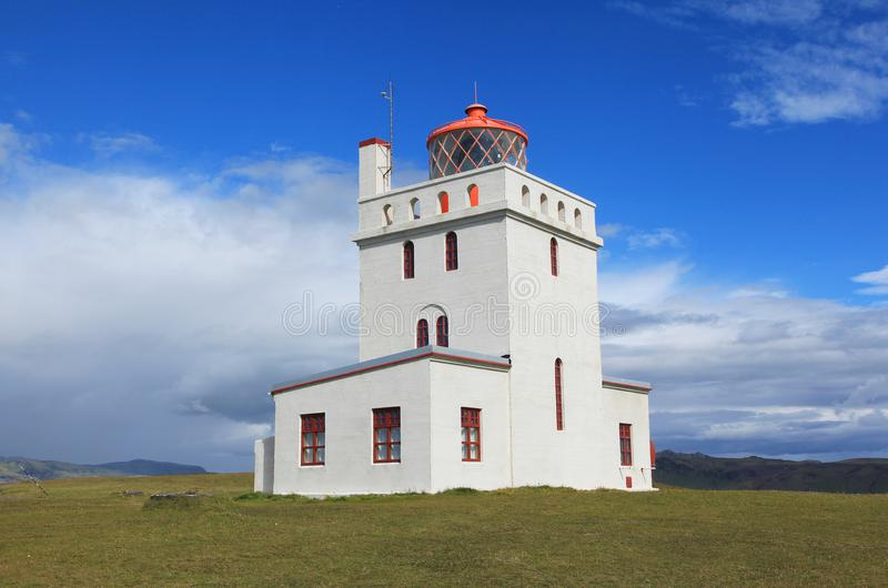 Dyrholaey Lighthouse in Iceland. Dyrholaey Lighthouse on a sunny day in Iceland royalty free stock photography