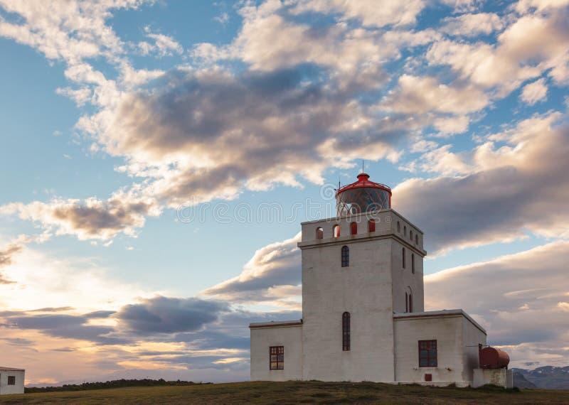 Dyrholaey lighthouse at sunset Vik South coast of Iceland. Dyrholay lighthouse Dyrhólaeyjarviti located on the Dyrhólaey promontory  near the village of V stock photo