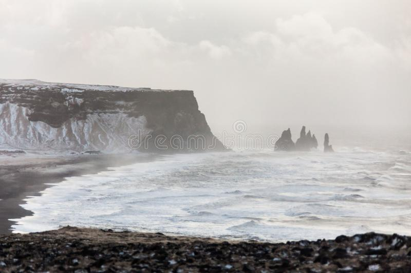 Dyrholaey view during winter snow. Which is small peninsula, or promontory located on the south coast village Vik Iceland royalty free stock images