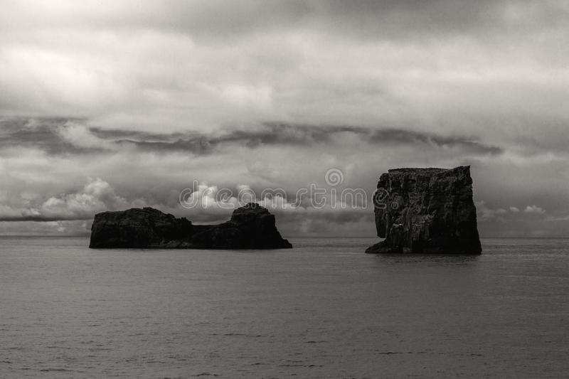 Dyrholay Rocks Iceland. Dyrhlaey Cape Portland at south coast of Iceland, Vik in black and white royalty free stock photos