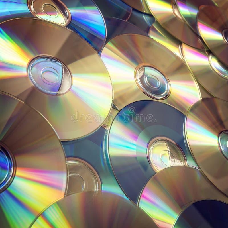 Dyski optyczni lub cd płyty kompaktowej tło fotografia stock