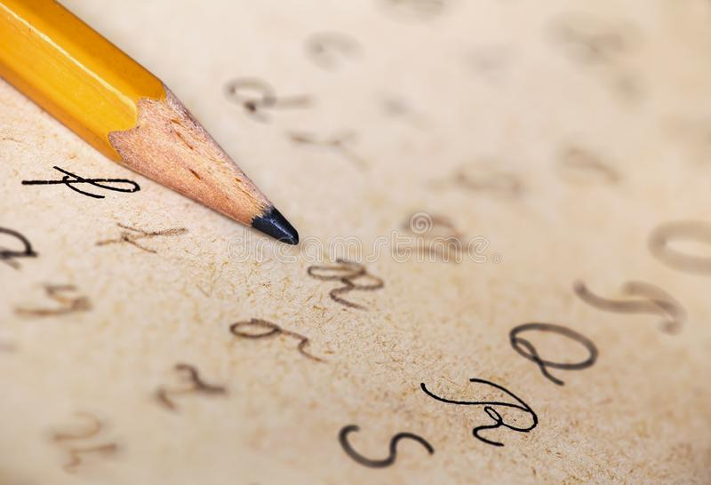 Dyslexia concept, pencil and alphabet handwriting stock image
